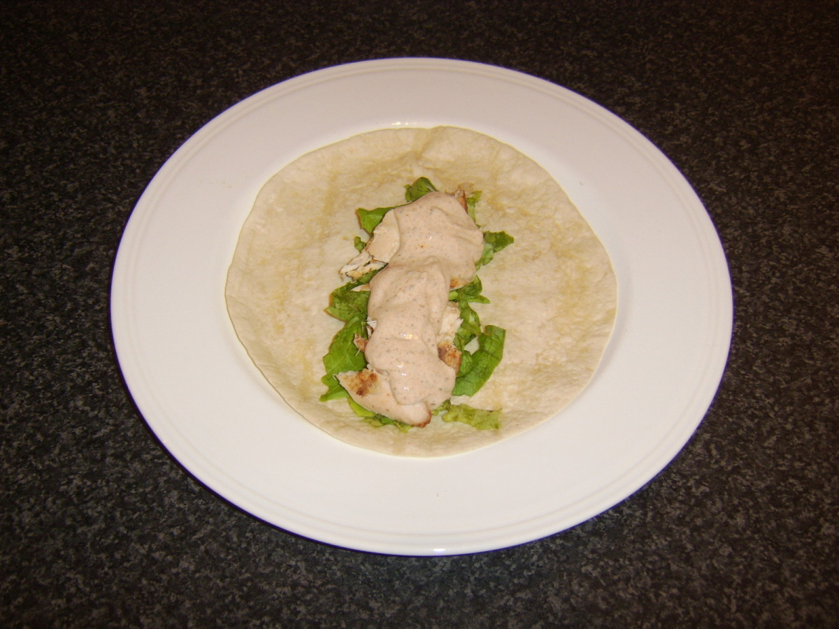 Leftover tandoori chicken is wrapped with lettuce and cumin raita