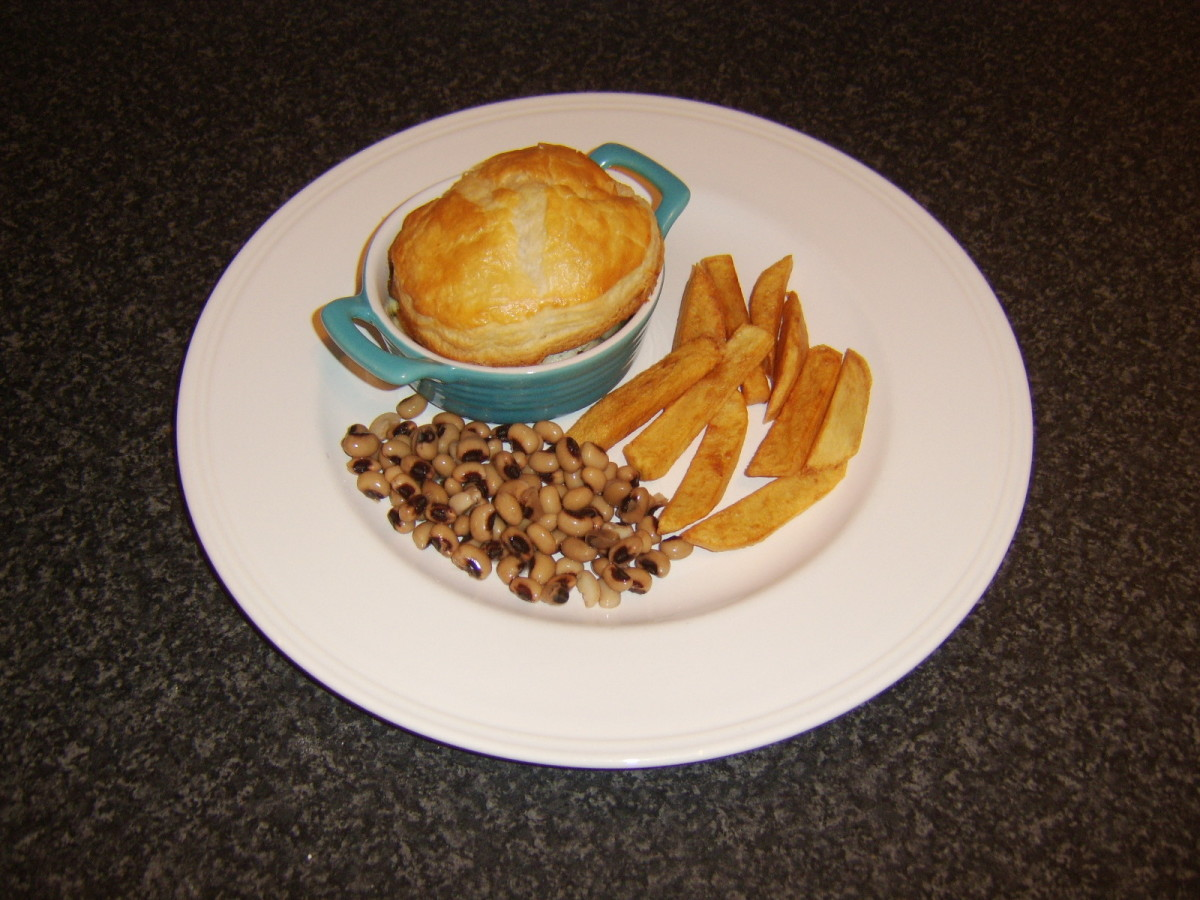 Leftover chicken is made in to a pie with mushrooms and served with chips and blackeye beans