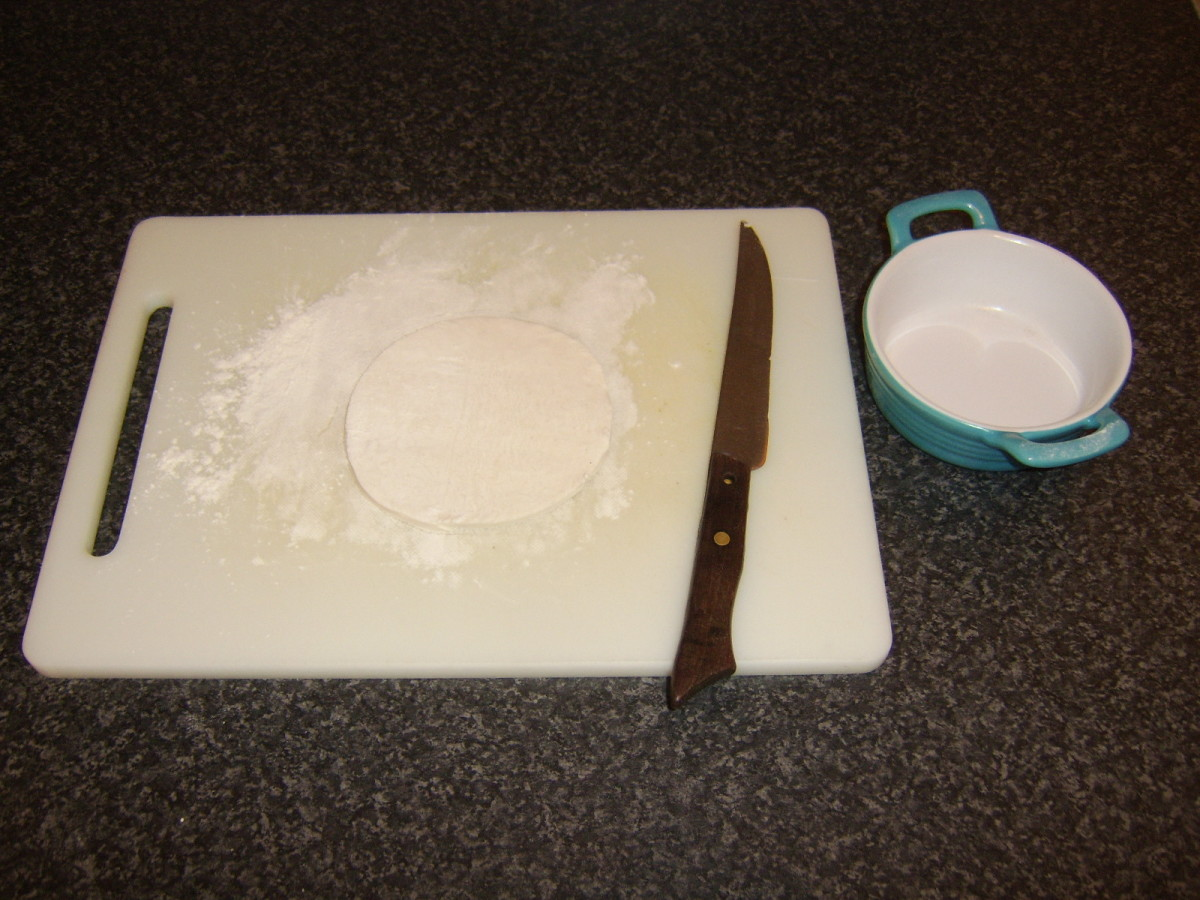 The pastry disc is cut and ready to be baked