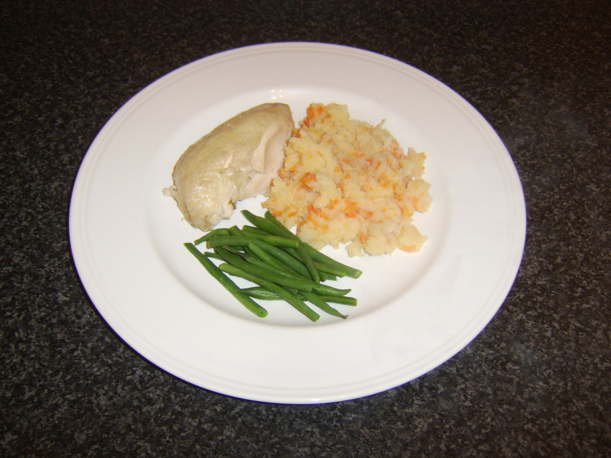 Poached chicken meal is assembled and ready to be garnished