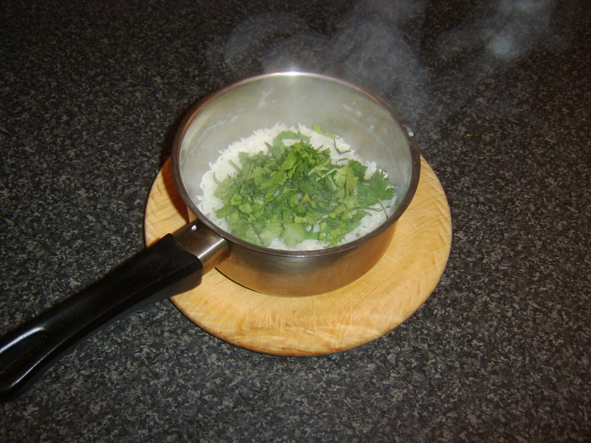 Chopped coriander/cilantro is added to the drained rice