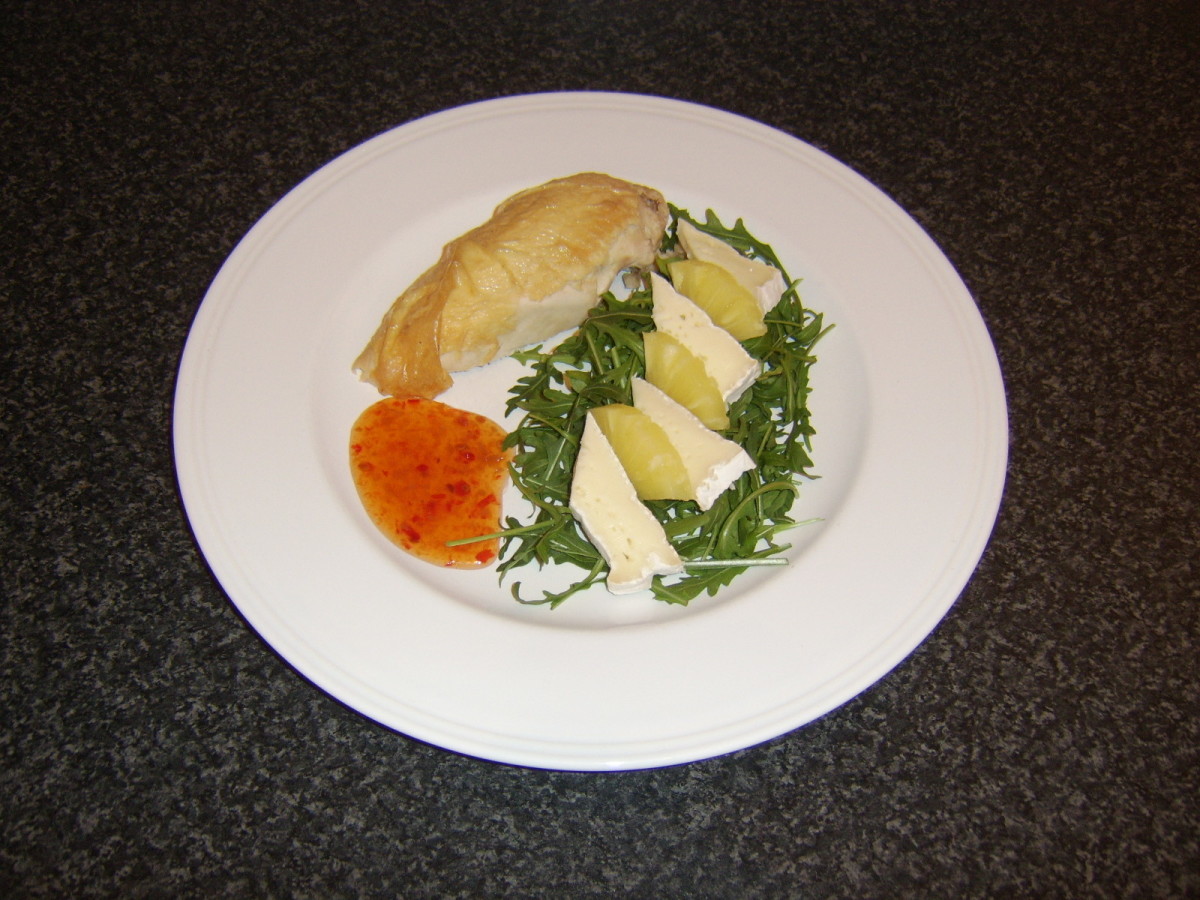 Leftover piece of roast chicken is served with a simple cheese and pineapple salad and sweet chilli sauce