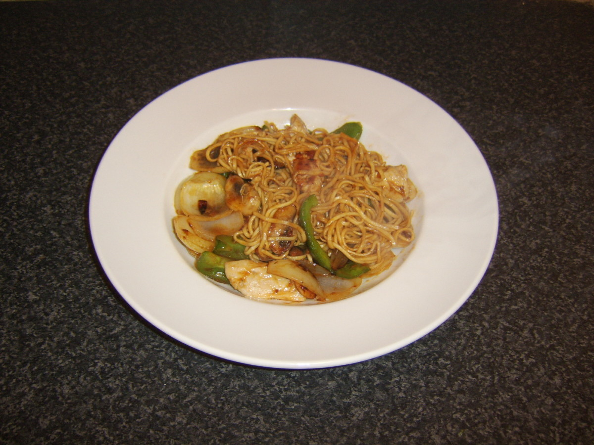 Leftover chicken is stir fried with vegetables and sweet and sour sauce and mixed with egg noodles