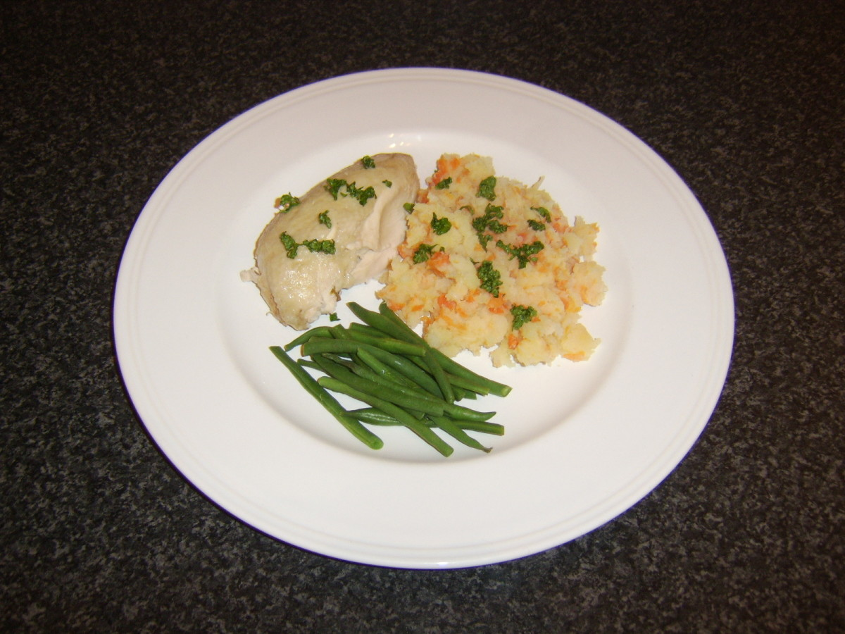 Poached chicken is served in portions with assorted root vegetable mash and trimmed green beans