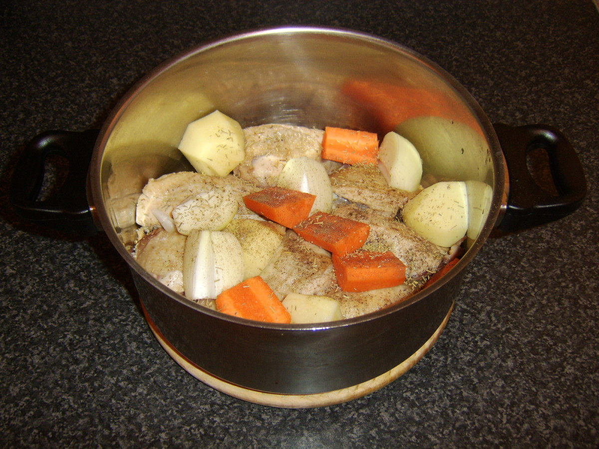 Vegetables, herbs and seasonings are added to the stew pot