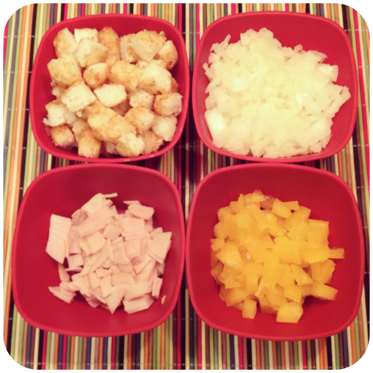 clockwise from top left: frozen tater tots, fresh yellow onion, fresh yellow bell pepper, sliced sandwich turkey,