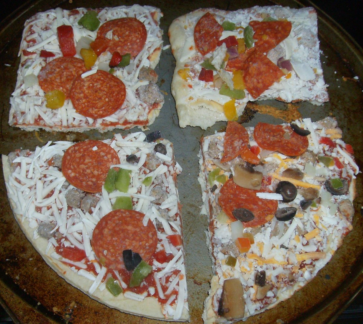 Note how frozen DiGiorno and Freschetta look alike (two square pieces at top of photo) and how Red Baron and Tombstone (two bottom pieces) resemble each other. Bottom right is the Red Baron; you can see it has more ingredients than the others.