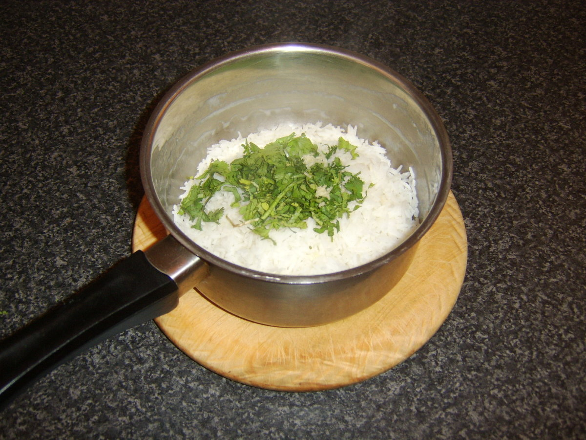 Coriander/cilantro and garlic are stirred through the rice