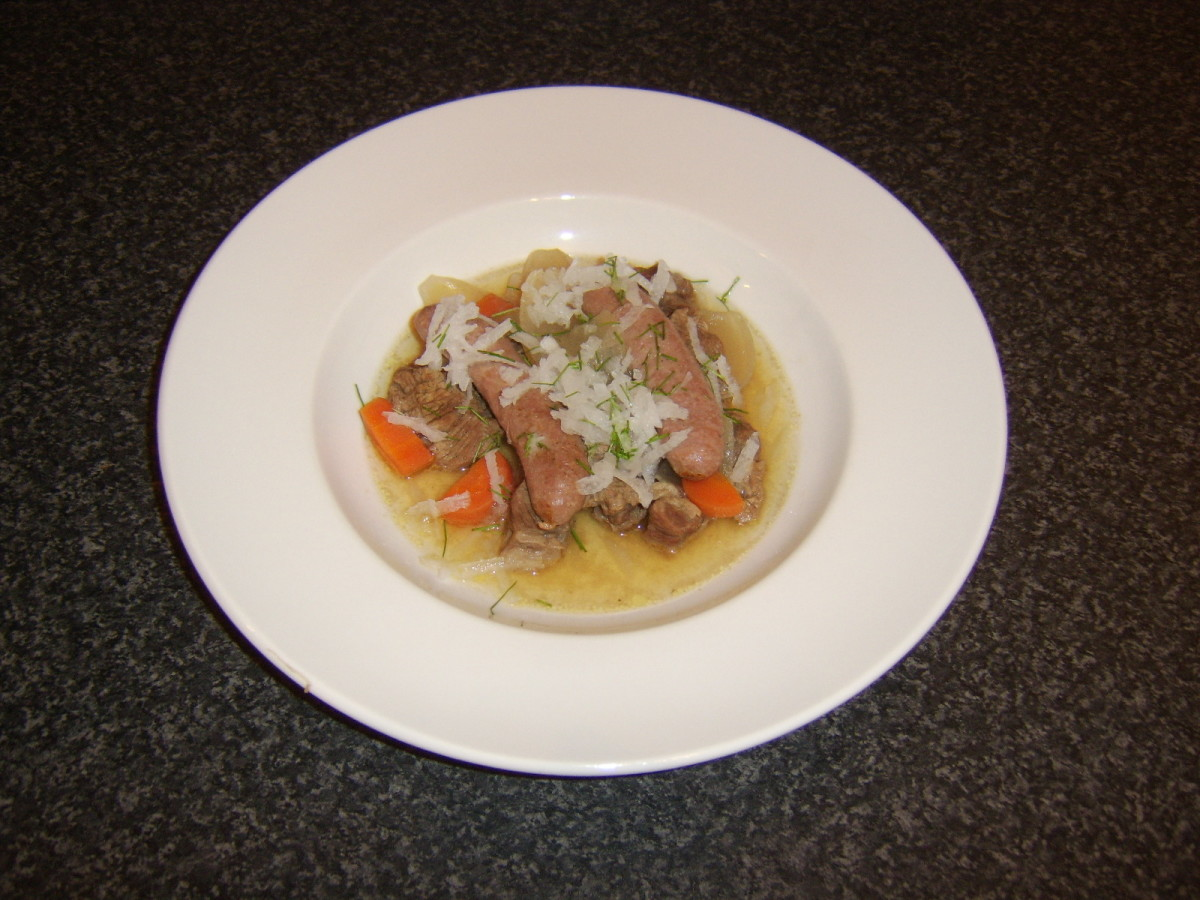 Casseroled beef and sausage is garnished with grated mooli and chopped chives