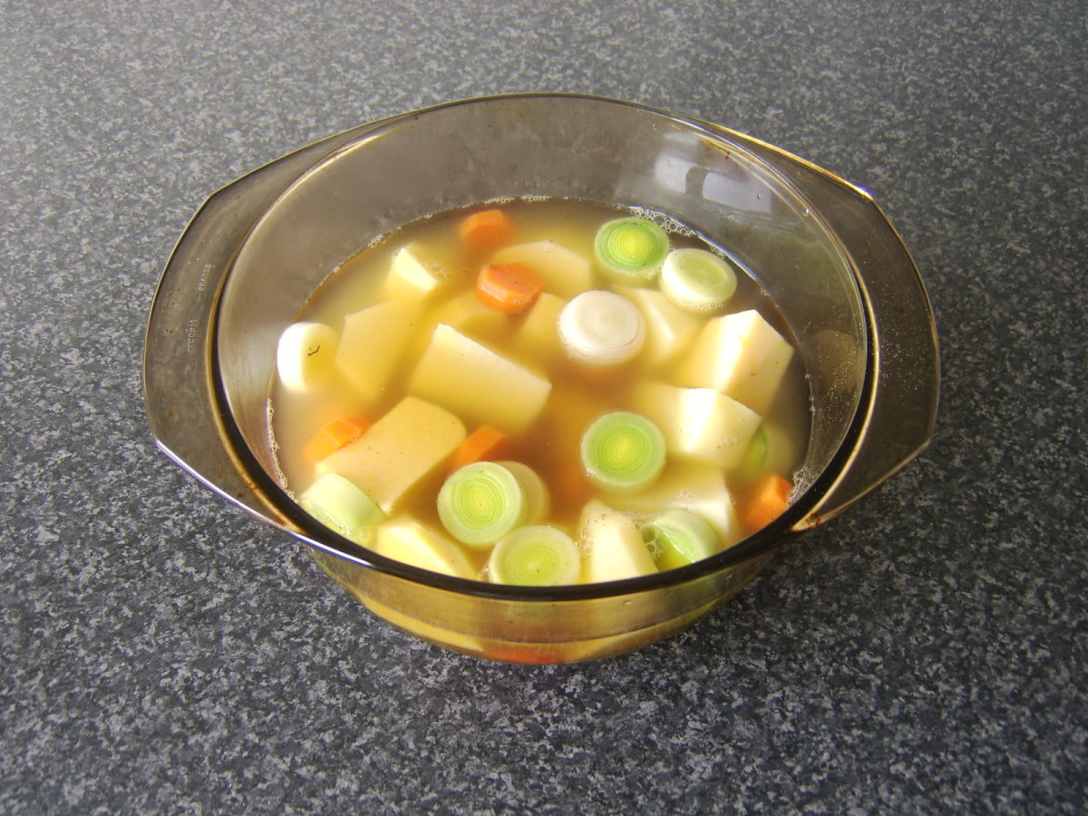 Stock is poured over vegetables and beans