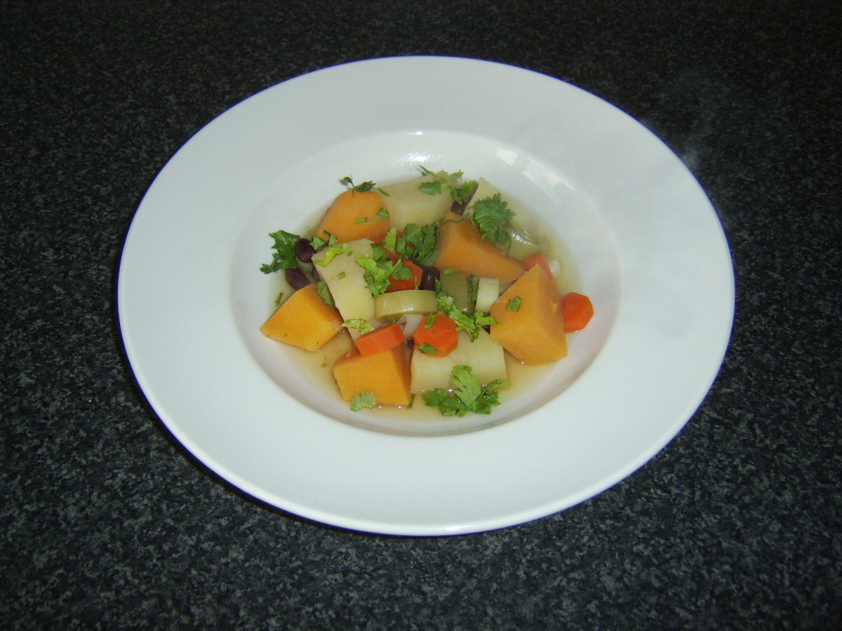 Selection of root vegetables are casseroled in stock with red kidney beans