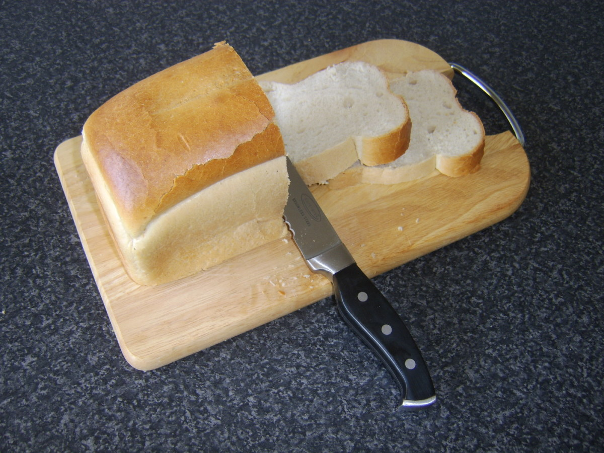 Fresh bread is served with beef casserole