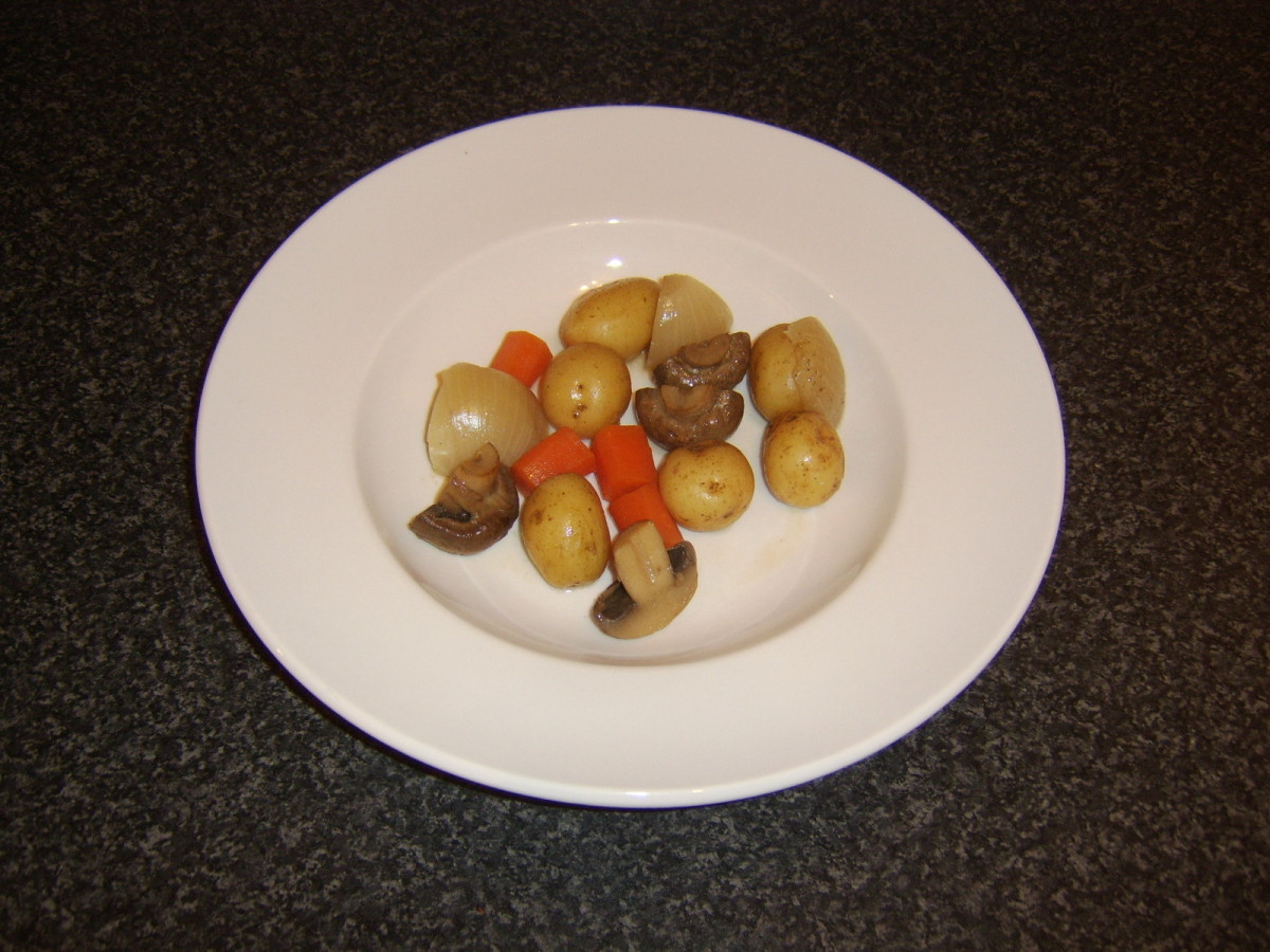 Vegetables are plated first when serving casserole