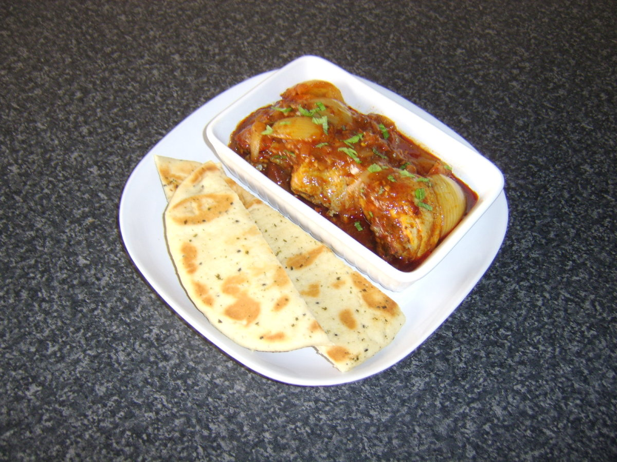 Chicken thighs are slowly casseroled in an Indian Jalfrezi sauce and served with garlic naan