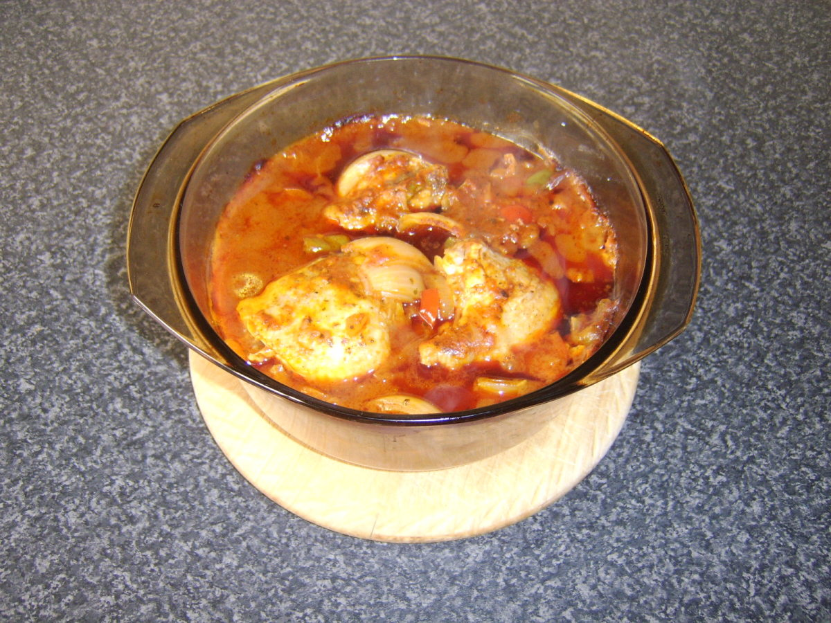 Jalfrezi casseroled chicken thighs are left to rest