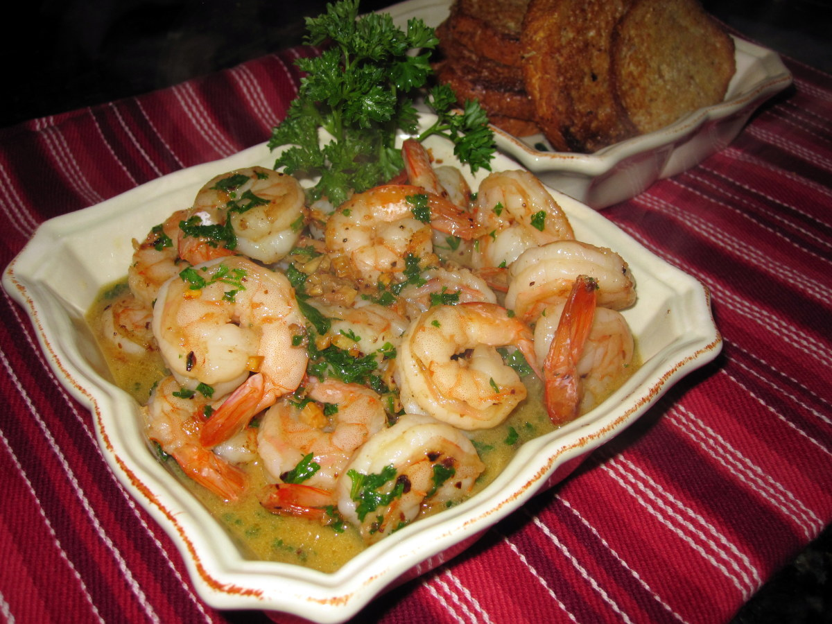 Small dishes of seafood, like these sizzling shrimp, are popular on tapas menus.