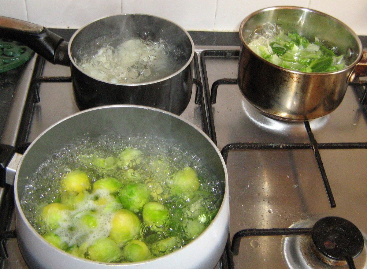 Cook the potatoes, cabbage and sprouts