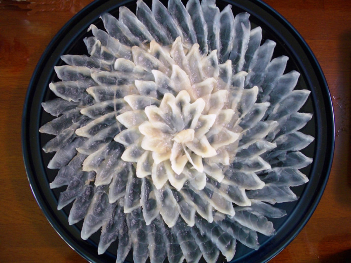 Artfully sliced and plated Fugu sashimi (blowfish)
