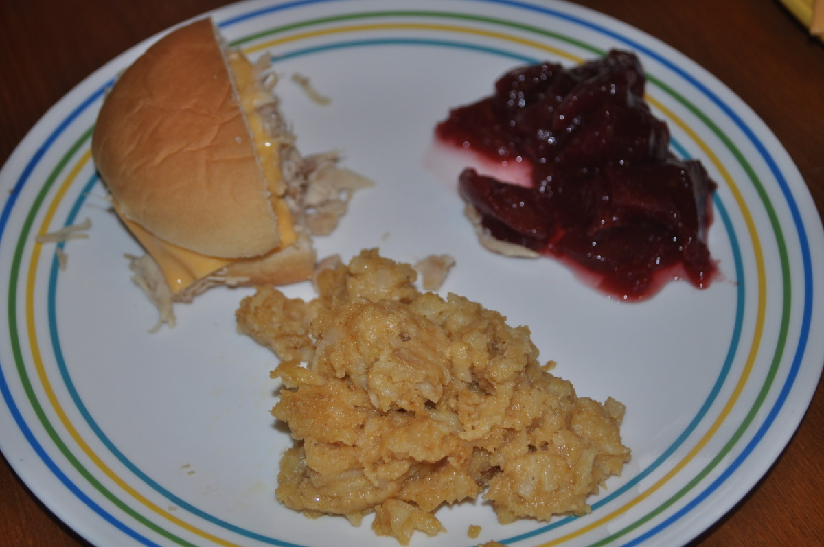 With tasty side dishes, you can offer your guests a complete meal they will rave about. Pictured with the cheesy potatoes is a turkey gravy sandwich with cheese and cranberries.