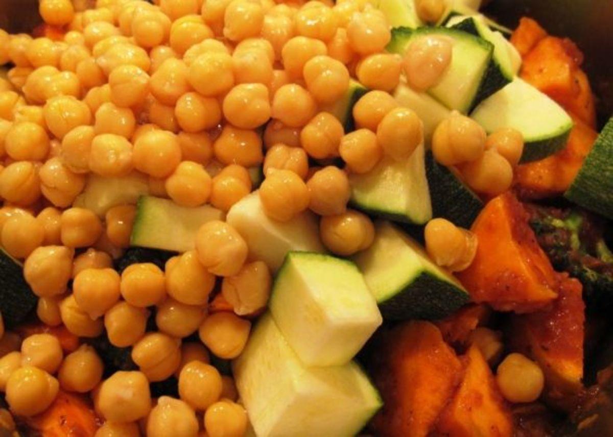 Step 5: Add chickpeas and zucchini.