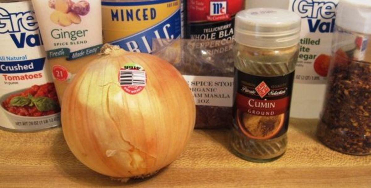 Step 1: Measure the spices and chop the onion.