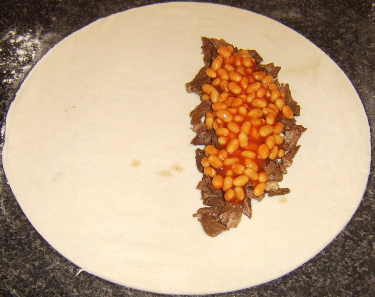 Beans are spooned on beef