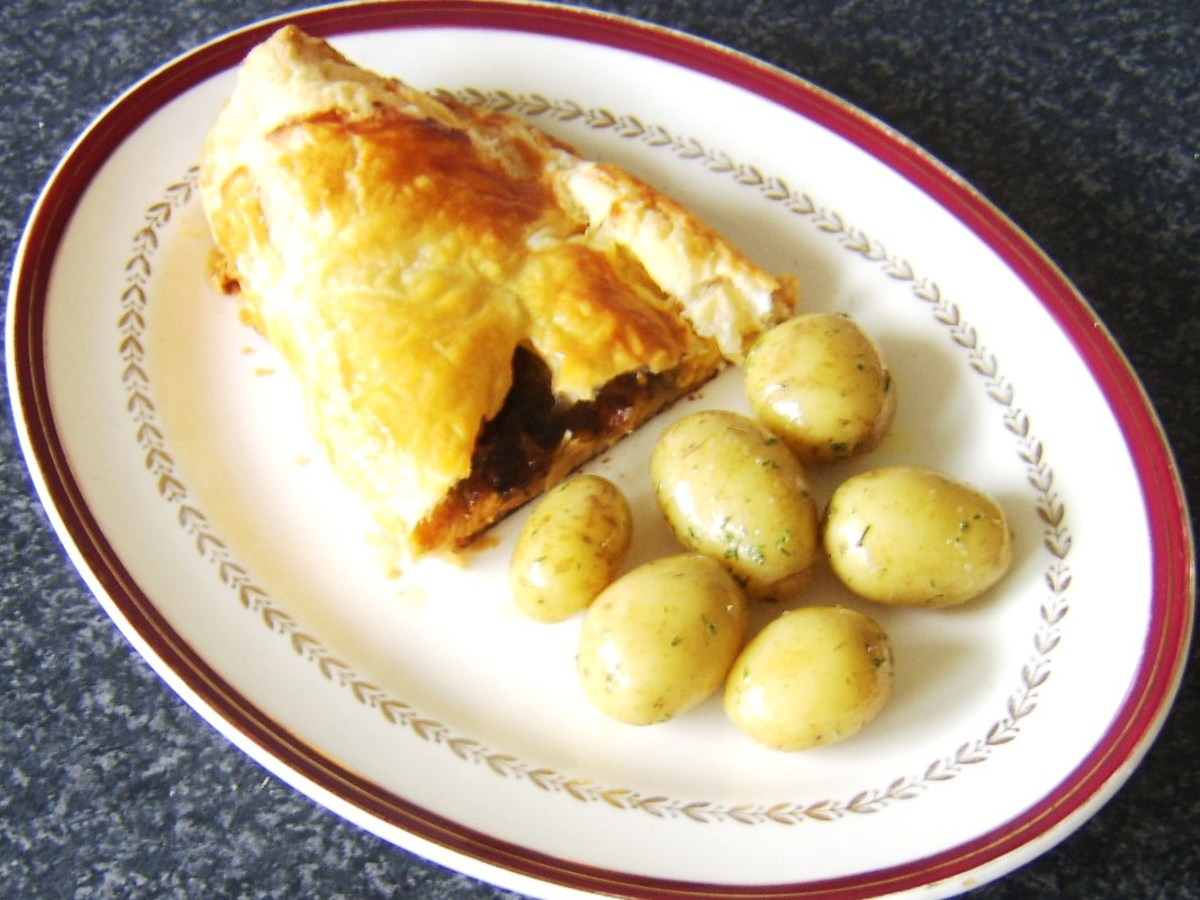 Cheese, pickle and onion pasty half served with dill buttered new potatoes