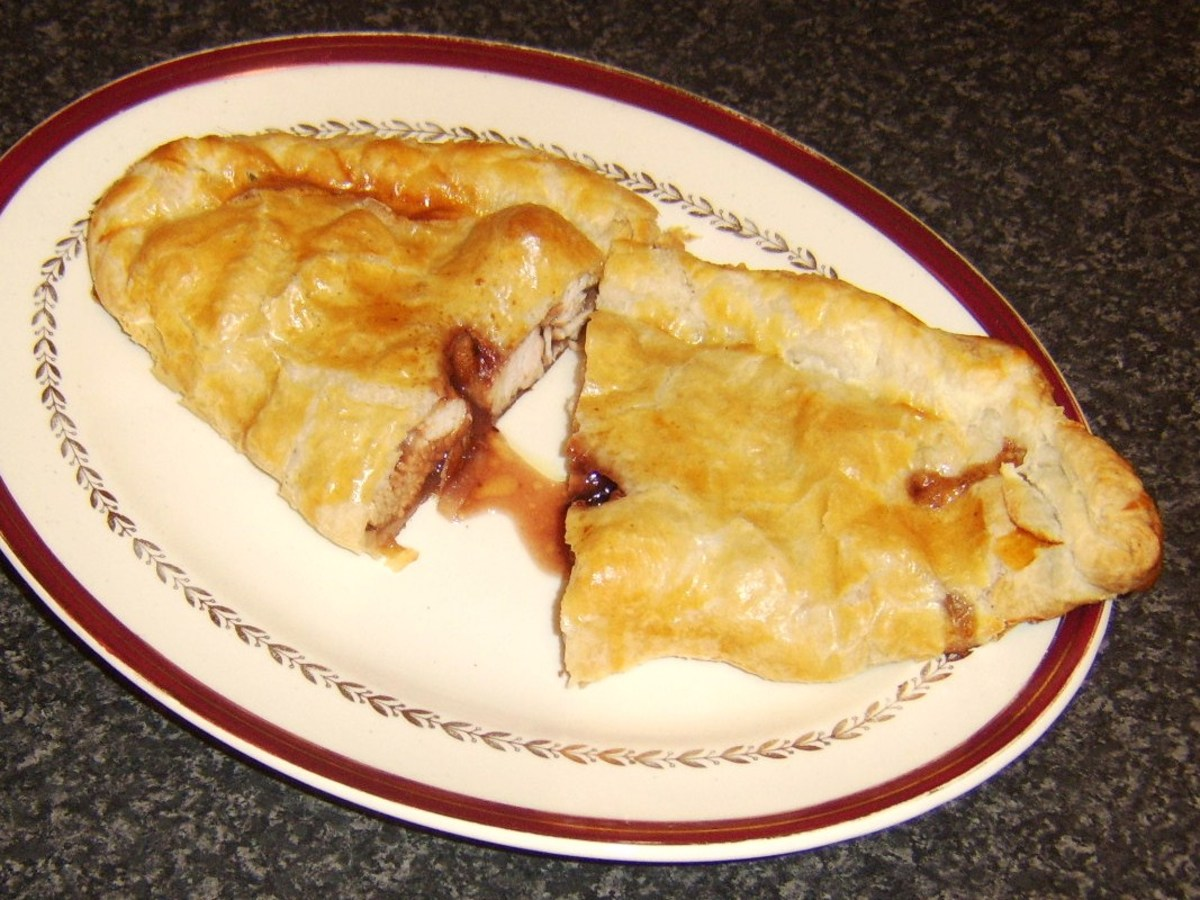 Cranberry and port sauce oozing temptingly from pasty