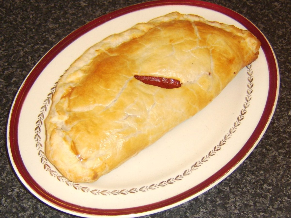 Sausage, bacon and tomato pasty removed from oven