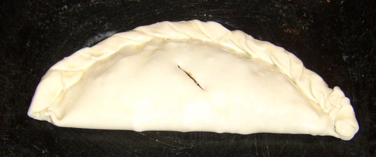 Pasty is filled, folded, glazed and ready to be baked
