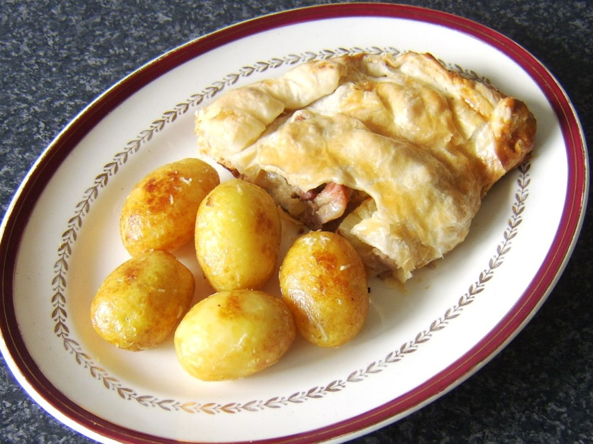 Spicy pork and pineapple pasty is served with garlic roast potatoes