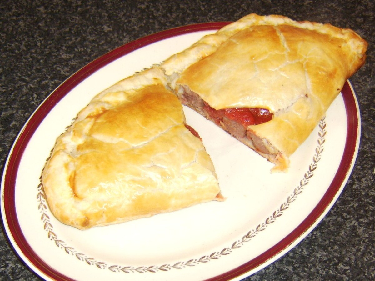 Halved sausage, bacon and tomato pasty