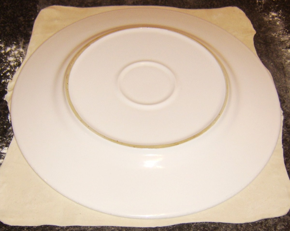 A dinner plate is used as a template to cut pastry
