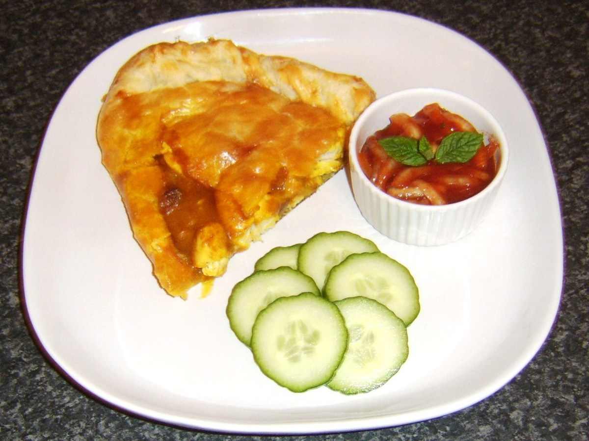 Chicken curry pasty, served with Indian spiced onions and cucumber