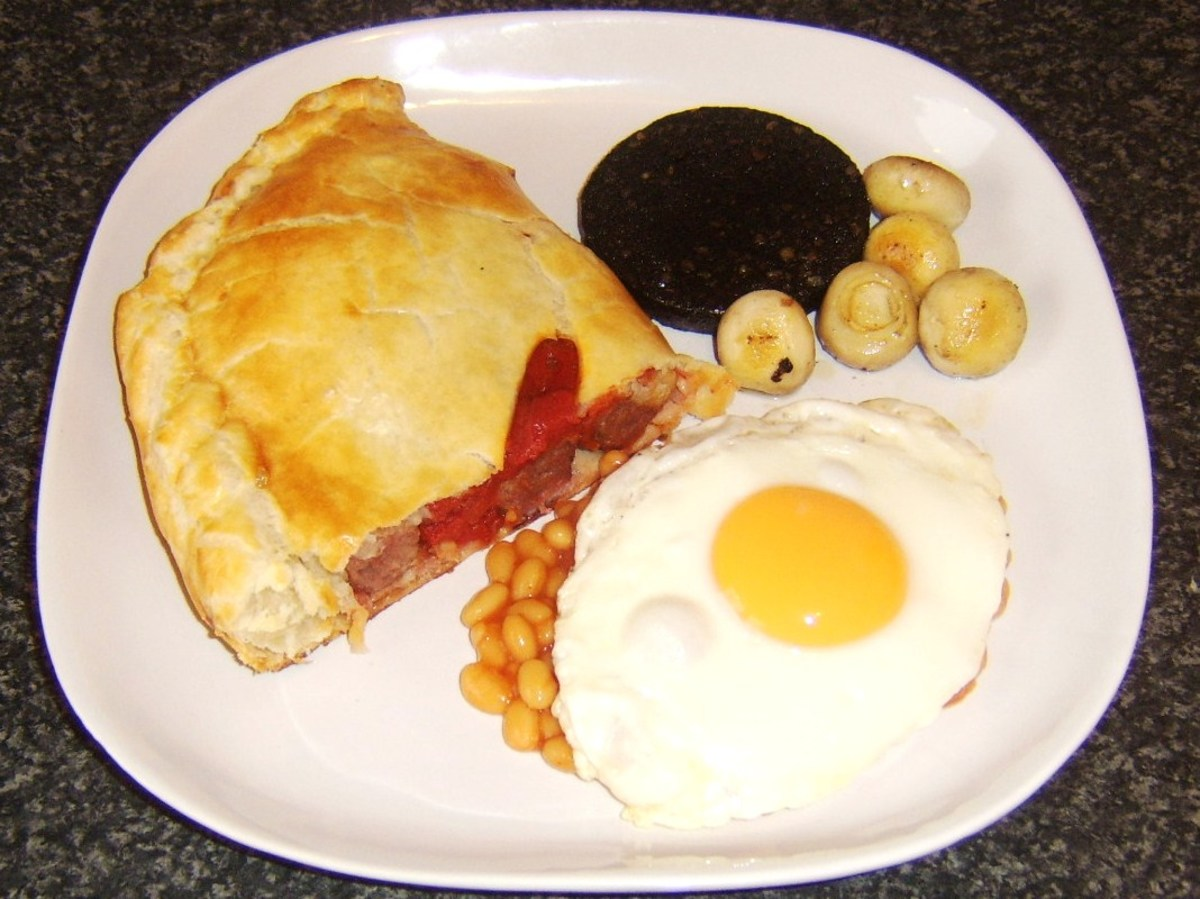 Half a sausage, bacon and tomato pasty is served with the more traditional fried breakfast ingredients that are black pudding, mushrooms, baked beans and a fried egg