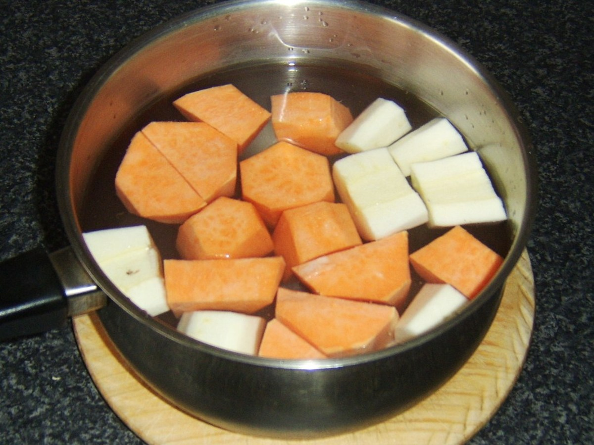 Sweet potatoes and parsnips are chopped and boiled