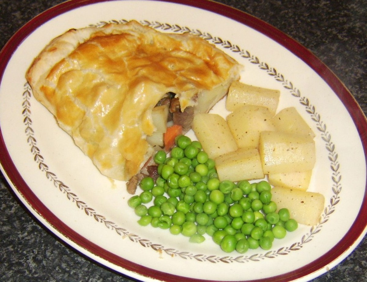 Lamb and root vegetable pasty served with nutmeg butter parsnips and peas