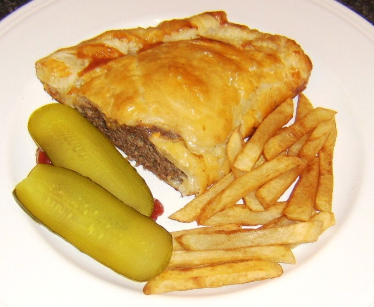 Half a cheeseburger pasty is served with homemade fries, relish and pickles
