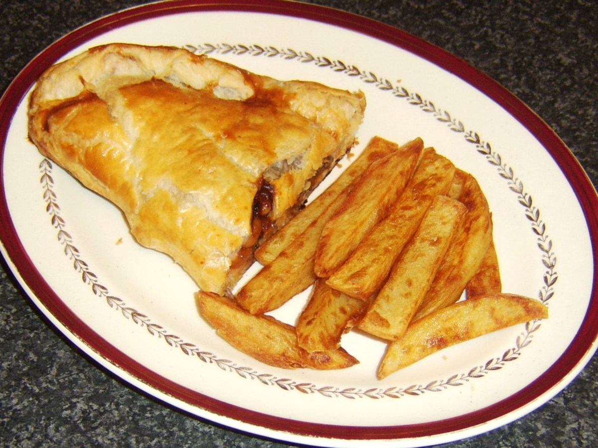 Beef, baked beans and pickle pasty served with freshly homemade chips