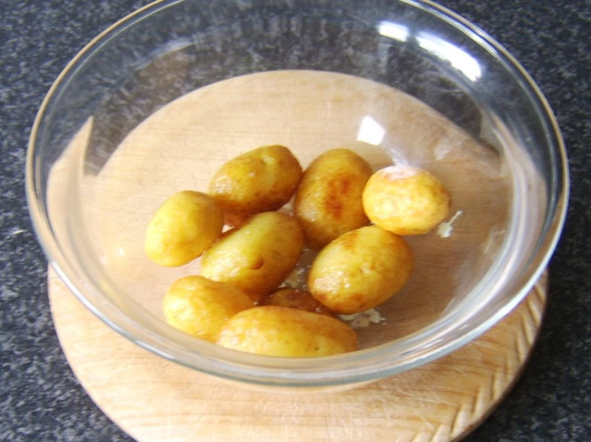 Roast potatoes are swirled in salt and garlic