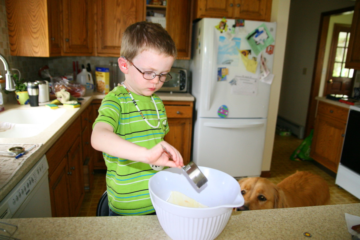 Nolan measured and added the lemon juice to the ingredients in the mixing bowl.