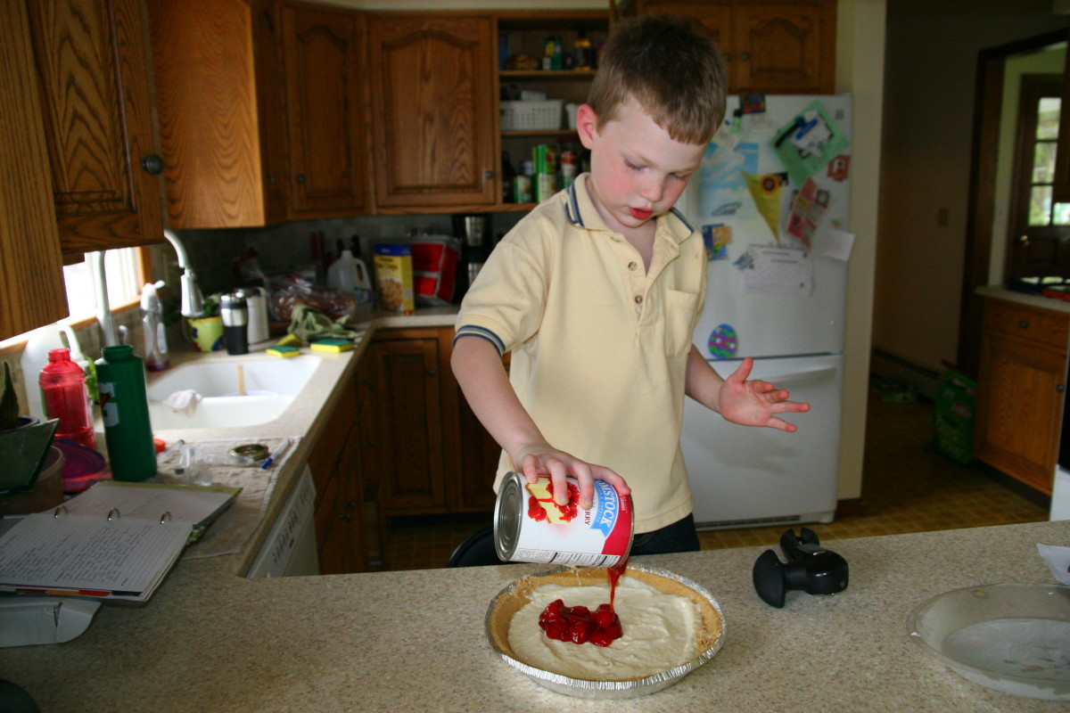 My six year old son opened the can of cherry pie filling and spread it on top of the pie!