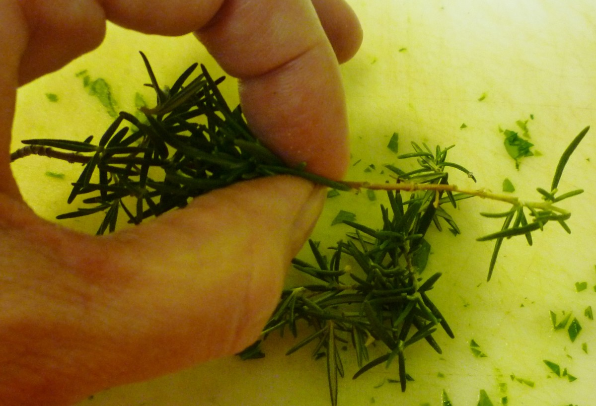 How to remove the rosemary leaves from the stem.  Just use your fingers and pull up towards the tip of the branch to remove the individual leaves.