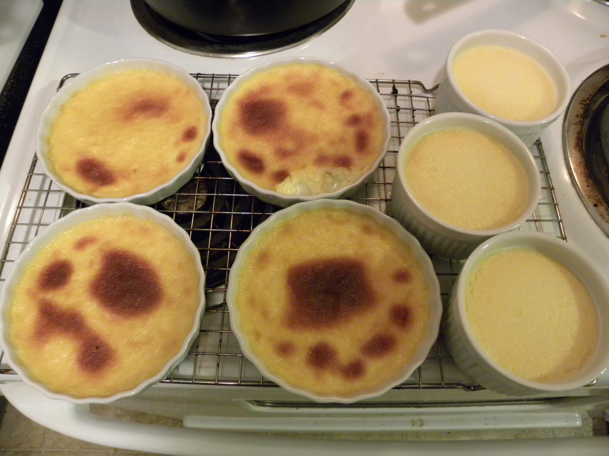 Finished Creme Brulee. The Ramekin's on the right are the ones I normally use, and the constency you want to shoot for. I slightly toasted the ones on the left