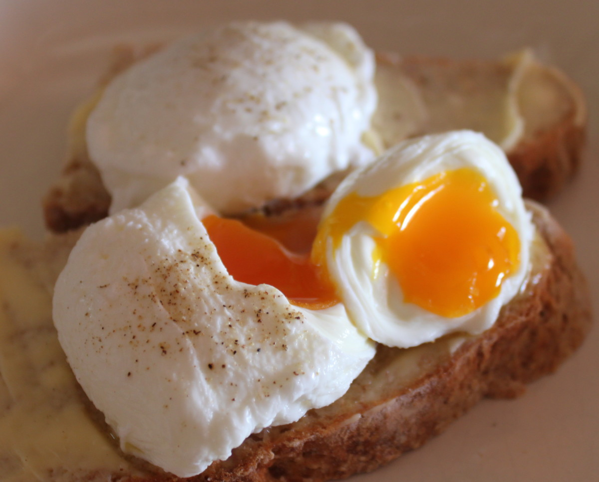 Poached eggs on buttered homemade brown soda bread, delicious and healthy.
