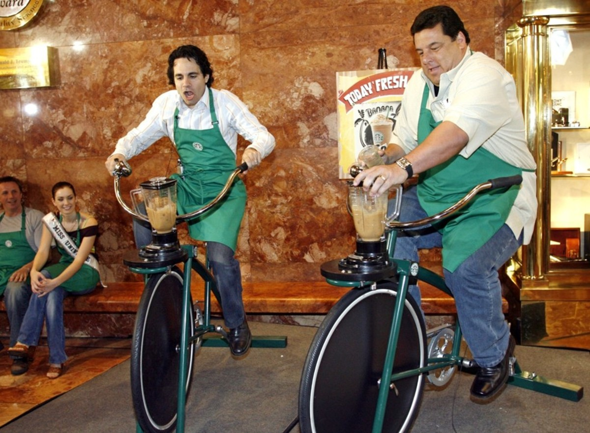 I'm not positive what Mario Cantone, Steve Schirippa and Natalie Glebova are doing here, but this is one of my favorite Starbucks related pics.