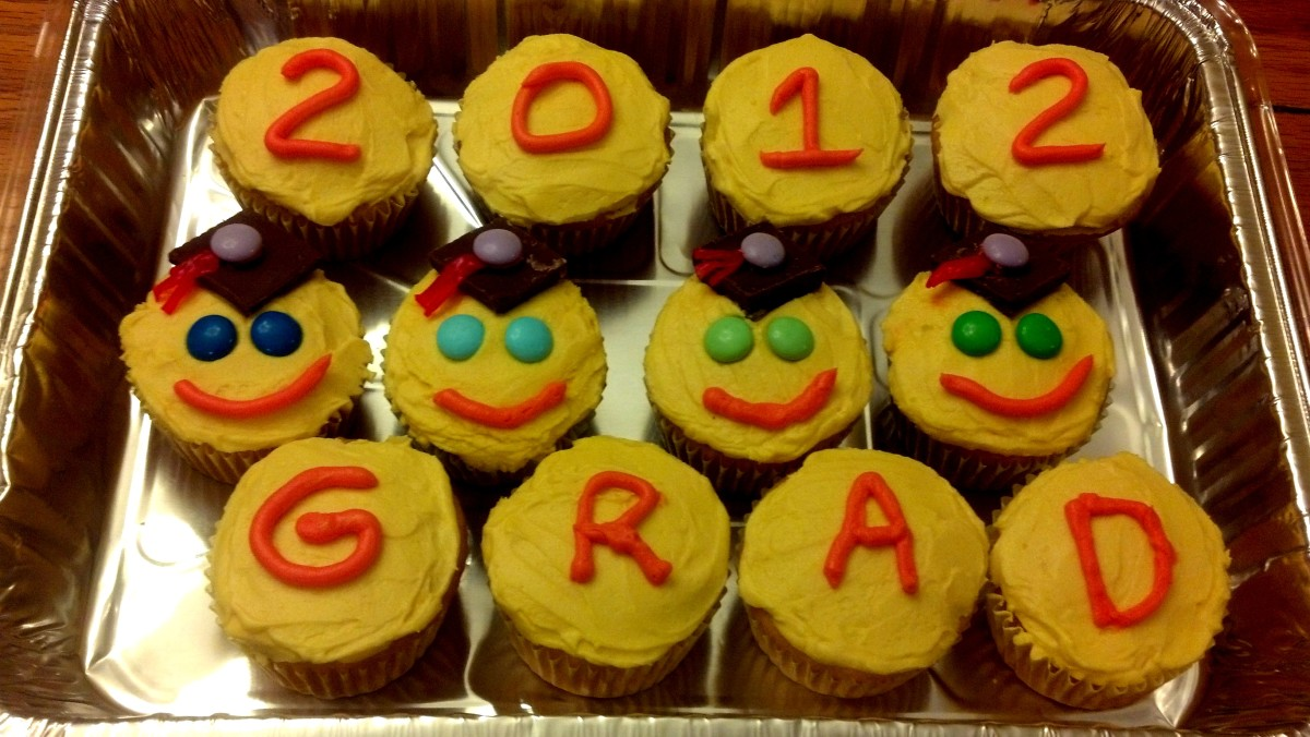 "We also left a few cupcakes plain to spell out ""2012 GRAD"" for those little ones who may not like candy toppings on their cupcakes."