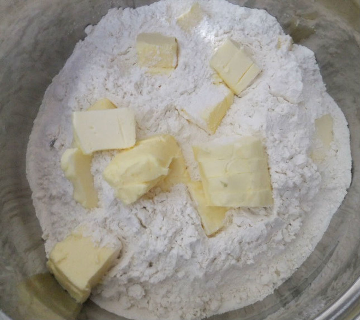 Add sliced butter to the flour