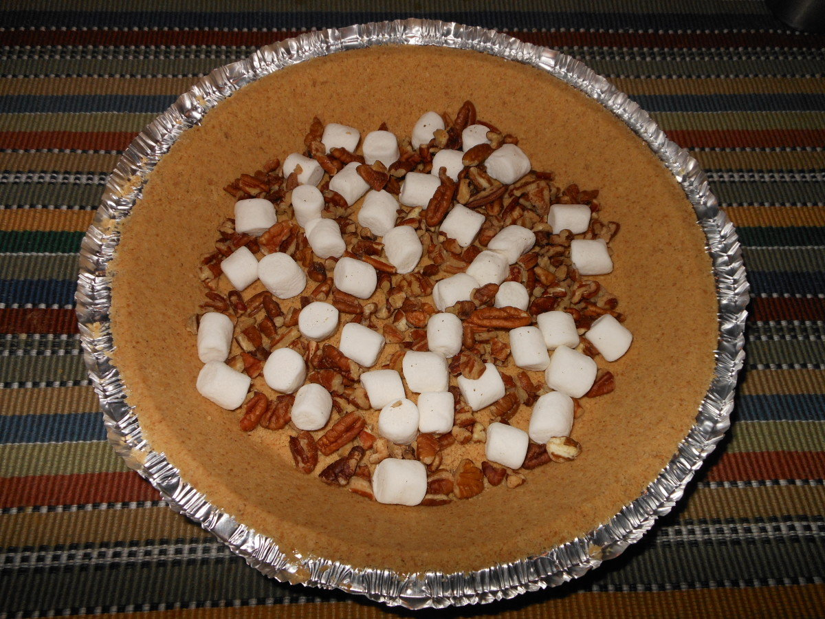 Spread the pecan pieces and marshmallows evenly across the bottom of the graham crust pie shell.