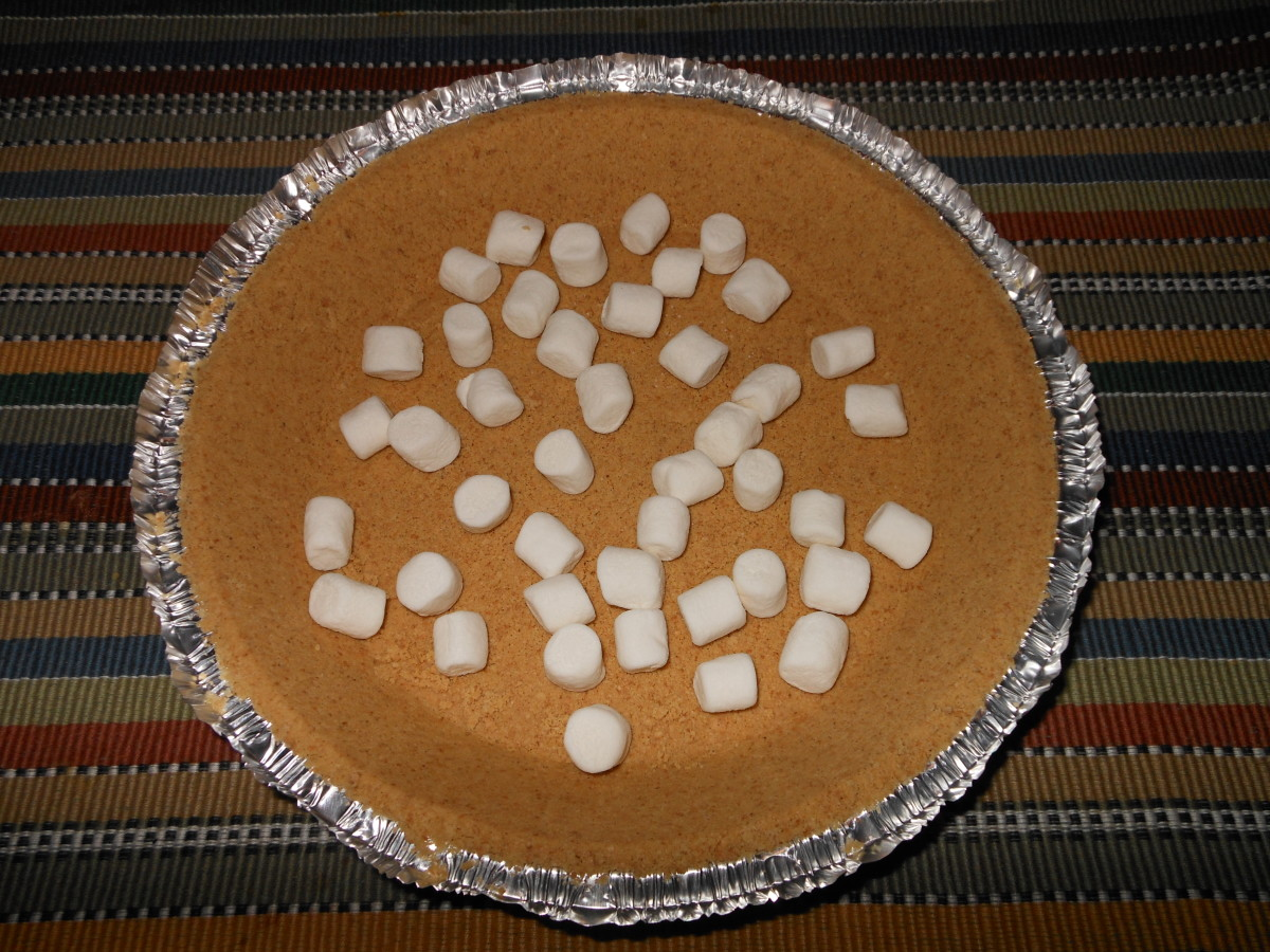 Add a 1/2 cup of miniature marshmallows and spread evenly across the bottom of the shell. Add more if desired.